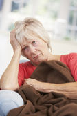 Sick, unhappy older woman at home — Stock Photo