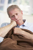 Sick, unhappy older man at home — Stock Photo