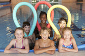 Children in swimming pool — Stock Photo