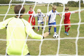 Player ready to score goal in Junior 5 a side — Stock Photo
