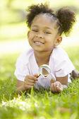 Young girl exploring nature — Stock Photo