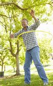 Senior man with hula-hoop — Stock Photo