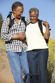 Senior couple on country hike — Stock Photo