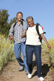 Senior couple on country hike — Stock Photo