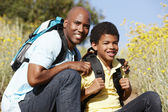 Father and son on country hike — Foto Stock