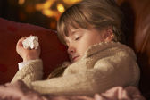 Sick Girl With Cold Resting On Sofa By Cosy Log Fire — Stock Photo