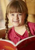 Young Girl Sitting On Wooden Seat Reading Book — Stock Photo