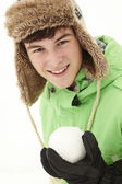 Teenage Boy Holding Snowball Wearing Fur Hat — Stock Photo
