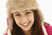 Portrait Of Teenage Girl In Snow Wearing Fur Hat — Stock Photo