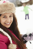 Teenage Couple Having Snowball Fight Wearing Fur Hats — Stock Photo