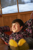 Teenage Boy Relaxing On Sofa — Stock Photo