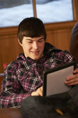 Teenage Boy Relaxing On Sofa With Tablet Computer — Stock Photo