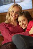 Portrait Of Mother And Daughter Relaxing On Sofa Together — Stock Photo