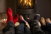 Close Up Of Familys Feet Relaxing By Cosy Log Fire With Marshmal — Stockfoto
