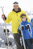 Father And Son On Ski Holiday In Mountains — Stock Photo