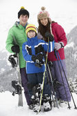 Group Of Children On Ski Holiday In Mountains — Stock Photo