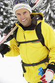 Middle Aged Man On Ski Holiday In Mountains — Stock Photo