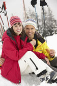 Middle Aged Couple Eating Sandwich On Ski Holiday In Mountains — Stock Photo