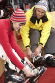 Couple On Trying On Ski Boots In Hire Shop — Stock Photo