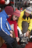 Family Trying On Ski Boots In Hire Shop — Stock Photo
