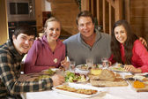 Teenage Family Enjoying Meal In Alpine Chalet Together — Stock Photo