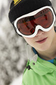 Teenage Boy Wearing Ski Goggles On Ski Holiday In Mountains — Foto Stock