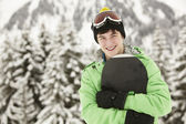Teenage Boy With Snowboard On Ski Holiday In Mountains — Stock Photo