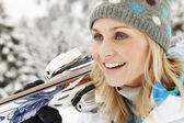 Middle Aged Woman On Ski Holiday In Mountains — Stock Photo