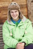 Teenage Boy Dressed For Cold Weather Sitting On Wooden Bench — Stock Photo