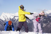 Teenage Family Having Snow Fight In Mountains — Stock Photo