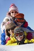 Group Of Children Having Fun On Ski Holiday In Mountains — Stock Photo