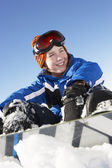 Young Boy Sitting In Snow With Snowboard — Stock Photo