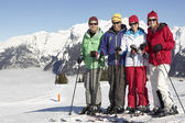 Group Of Middle Aged Couples On Ski Holiday In Mountains — Stockfoto