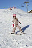 Young Girl Skiing Down Slope Whilst On Holiday In Mountains — Foto Stock