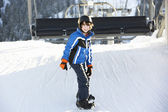 Young Boy Getting Off chair Lift On Ski Holiday In Mountains — Stock Photo