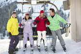 Teenage Family Getting Off chair Lift On Ski Holiday In Mountain — Stock Photo