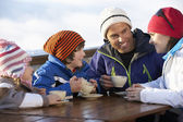 Family Enjoying Hot Drink In Café At Ski Resort — Stok fotoğraf