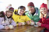 Teenage Family Enjoying Hot Drink In Café At Ski Resort — Stock Photo