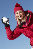Woman About To Throw Snowball Wearing Warm Clothes On Ski Holida — Stock Photo