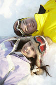 Overhead View Of Two Teenagers On Ski Holiday In Mountains — Stock Photo