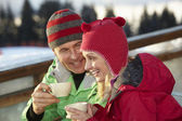 Couple Enjoying Hot Drink In Café At Ski Resort — Stock Photo