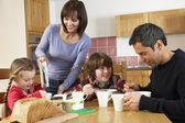 Family Eating Breakfast Together In Kitchen — Stock Photo