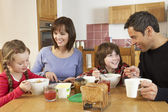 Family Eating Breakfast Together In Kitchen — Foto Stock