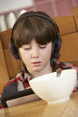 Boy Using Tablet Computer Whilst Eating Breakfast — Stock Photo