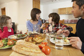 Family Having Argument Whilst Eating Lunch Together In Kitchen — Stock Photo