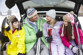 Teenage Family Sitting In Boot Of Car With Skis — Stock Photo