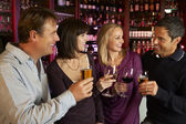 Group Of Friends Enjoying Drink Together In Bar — Stok fotoğraf