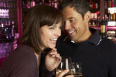 Couple Enjoying Drink Together In Bar — Stockfoto