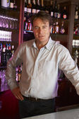 Portrait Of Barman Standing Behind Bar — Stock Photo