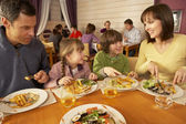 Family Eating Lunch Together In Restaurant — Stock Photo